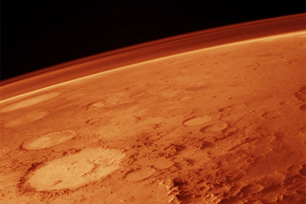 The atmosphere on Mars, seen here on the horizon