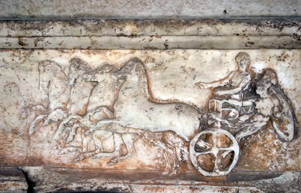 Ancient greek chariot race bas-relief