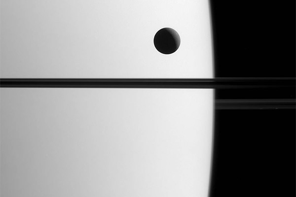 Dione transiting Saturn, photographed by the Cassini spacecraft