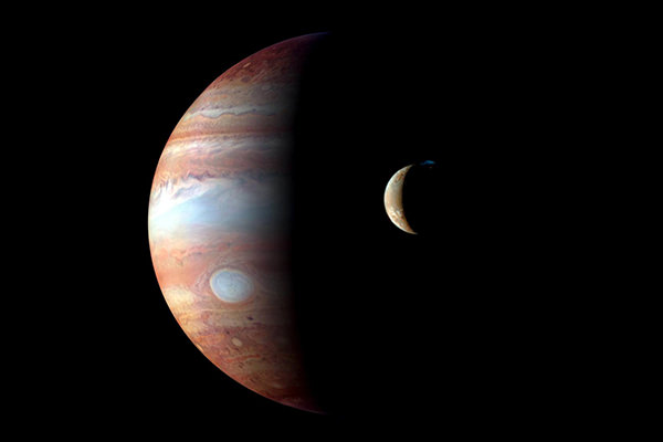 Jupiter and moon Io, captured by New Horizon in 2007